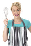 Attractive Young Woman Holding a kitchen Whisk Stock Photo