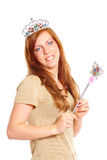 Attractive young woman holding a magic wand Royalty Free Stock Image