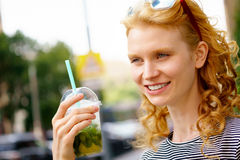 Attractive young woman holding mojito in hand stock photos