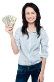 Attractive young woman holding money Royalty Free Stock Image