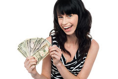 Attractive young woman holding money Royalty Free Stock Photos