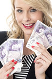 Attractive Young Woman Holding Money Royalty Free Stock Photography