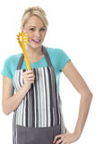 Attractive Young Woman Holding a Pasta Fork Stock Image