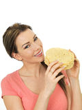 Attractive Young Woman Holding A Pile Of Indian Style Poppadoms Royalty Free Stock Image