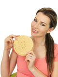 Attractive Young Woman Holding A Pile Of Indian Style Poppadoms Royalty Free Stock Photos