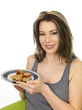 Attractive Young Woman Holding a Plate of Chinese Style Sesame T Stock Photography