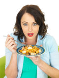 Attractive Young Woman Holding a Plate of Seafood Linguine Royalty Free Stock Images