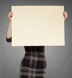 Attractive young woman holding poster Royalty Free Stock Photography