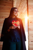 Attractive young woman holding present  for your loved ones Stock Image