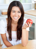 Attractive young woman holding a red an apple Stock Photos