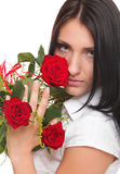 Attractive young woman holding a red rose Royalty Free Stock Images