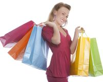 Attractive young woman holding several shoppingba Royalty Free Stock Photos