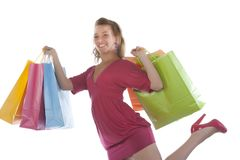 Attractive young woman holding several shoppingba Royalty Free Stock Image