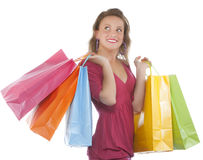 Attractive young woman holding several shoppingbag Royalty Free Stock Photos