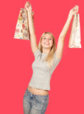Attractive young woman holding shopping bags Royalty Free Stock Photography