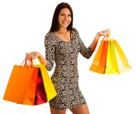 Attractive young woman holding shopping bags isolated over white Royalty Free Stock Photos