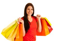 Attractive young woman holding shopping bags isolated over white Royalty Free Stock Photo