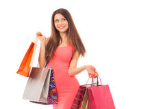 Attractive young woman holding shopping bags Royalty Free Stock Image