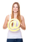 Attractive young woman holding at sign Stock Images