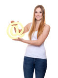 Attractive young woman holding at sign Royalty Free Stock Photo