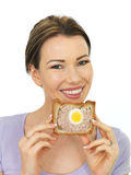 Attractive Young Woman Holding A Slice Of Gala Pie Stock Photography