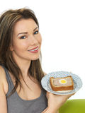 Attractive Young Woman Holding a Slice of Gala Pie Royalty Free Stock Image
