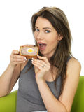 Attractive Young Woman Holding a Slice of Gala Pie Royalty Free Stock Photos
