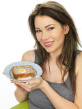 Attractive Young Woman Holding a Slice of Gala Pie Royalty Free Stock Photography