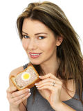 Attractive Young Woman Holding a Slice of Gala Pie Stock Photos