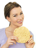Attractive Young Woman Holding A Stack Of Indian Style Poppadoms Royalty Free Stock Image