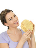 Attractive Young Woman Holding A Stack Of Indian Style Poppadoms Royalty Free Stock Images