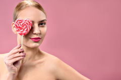 Attractive young woman holding sweetmeat royalty free stock photos