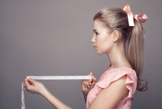 Attractive Young Woman Holding Tape Measure Stock Photos