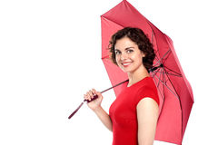 Attractive young woman holding an umbrella Royalty Free Stock Image