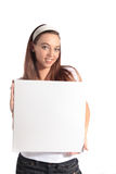 Attractive young woman holding white board Stock Images