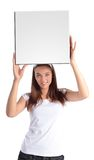 Attractive young woman holding white board Royalty Free Stock Photos