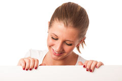 Attractive young woman holding white board Stock Image