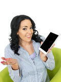 Attractive Young Woman Holding a Wireless Tablet Stock Photo