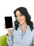 Attractive Young Woman Holding a Wireless Tablet Royalty Free Stock Image
