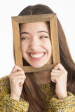 Attractive young woman holding wooden frame Stock Image