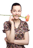 Attractive young woman holding a yellow tulip. On white background stock photos