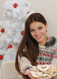 Attractive young woman with home cookies for Christmas holiday a Stock Photos