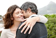 Attractive young woman hugging her husband Stock Photography