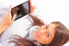 Attractive young woman with ipod Royalty Free Stock Photography