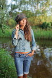 Attractive young woman in jean and beret Stock Photography