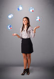 Attractive young woman juggling with social network icons Royalty Free Stock Photo