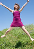 Attractive young woman jumping Royalty Free Stock Photo
