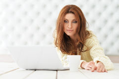 Attractive young woman with laptop. At home Stock Photo