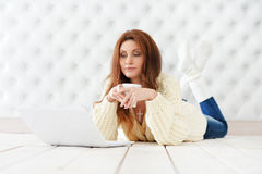 Attractive young woman with laptop. At home Royalty Free Stock Photography