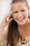 Attractive young woman laughing Royalty Free Stock Photos